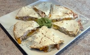 Air Fried Cheese Chicken Quesadilla with onion and yellow orange peppers